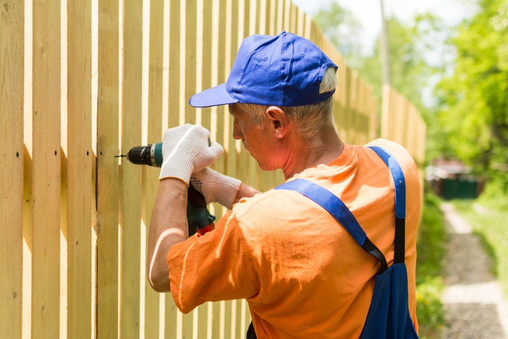contractor working on fence